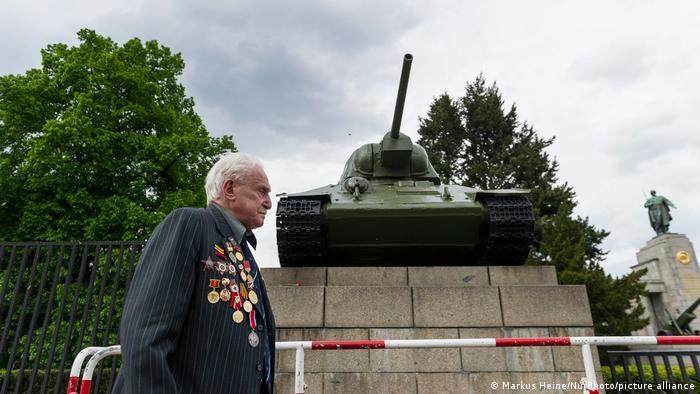 Dushman walks below the Soviet June 17 memorial in Berlin, topped by a tank