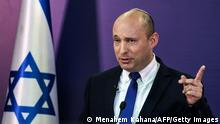 Naftali Bennett, Israeli parliament member from the Yamina party, gives a statement at the Knesset, Israel's parliament, in Jerusalem on June 6, 2021. - In power for 12 consecutive years, Israel's embattled Prime Minister Benjamin Netanyahu faces being toppled by a motley coalition of lawmakers united only by their shared hostility towards him. Under the agreement, the right-wing nationalist Bennett would be premier for two years, to be replaced by the centrist Yair Lapid of the Yesh Atid party in 2023. (Photo by Menahem KAHANA / AFP) (Photo by MENAHEM KAHANA/AFP via Getty Images)