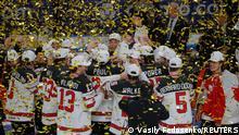 Ice Hockey - IIHF World Ice Hockey Championship 2021 - Final - Gold Medal Game - Finland v Canada - Arena Riga, Riga, Latvia - June 6, 2021 Canada players celebrate after winning the IIHF World Ice Hockey Championship 2021 REUTERS/Vasily Fedosenko