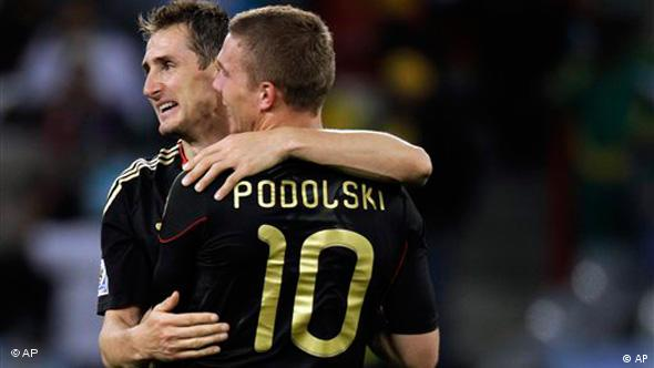 Germany's Miroslav Klose, face to camera, and Germany's Lukas Podolski during the World Cup quarterfinal soccer match between Argentina and Germany