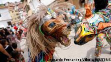 A member of Venezuelan brotherhood Dancing Devils dances during their annual Corpus Christi celebration with a call for the end of the coronavirus disease (COVID-19), in Naiguata, Venezuela June 3, 2021. Picture taken June 3, 2021. REUTERS/Leonardo Fernandez Viloria