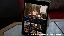 A tablet on the breakfast table of Alparslan Atas and his wife Gulistan at their home in Istanbul, shows the latest video of Sedat Peker, a Turkish fugitive crime boss, Sunday, June 6, 2021. Sunday is the day the 49-year-old convicted crime ringleader posts the latest installation of his hour-long tell-all videos from his stated base in Dubai that have captivated Turkey and turned the mobster into an unlikely social media phenomenon. The convicted crime ringleader has been dishing the dirt on members of Turkish President Recep Tayyip Erdogan's ruling party. The allegations range from drug trafficking and a murder cover-up to weapons transfers to Islamic militants. (AP Photo/Mehmet Guzel)