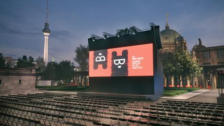 A Berlinale promotional image, two cartoon bears on a red screen, at an open-air cinema with the Berlin TV Tower and Berlin Cathedral in the background.