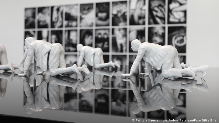 Patricia Kaersenhout artwork 'Mea Culpa': sculptures of white people in business suits on their hands and knees.