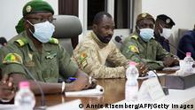 22.8.2020, Bamako, Mali, President of the CNSP (National Committee for the Salvation of the People) Assimi Goita (C) prepares for a meeting between Malian military leaders and an ECOWAS delegation headed by former Nigerian president on August 22, 2020, in an aim to restore order after the military coup in Bamako. - West African envoys held talks with Mali's military junta on August 22 to try to push for a speedy return to civilian rule after a coup in the troubled nation. The delegation, headed by former Nigerian president Goodluck Jonathan, held talks for half an hour with soldiers who seized power on August 18, including new strongman colonel Assimi Goita, an AFP journalist said. The envoys from the the regional ECOWAS bloc also hope to meet ousted president Ibrahim Boubacar Keita, who is being detained by the junta at a military camp outside Bamako. (Photo by ANNIE RISEMBERG / AFP) (Photo by ANNIE RISEMBERG/AFP via Getty Images)