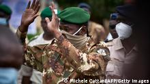 18.9.2020, Bamako, Mali, Colonel Assimi Goita, president of the CNSP (National Committee for the Salvation of the People), gestures as he arrives at the funeral of former Mali President General Moussa Traore in Bamako on September 18, 2020. - Mali held a state funeral for former Mali president Moussa Traore on September 18, 2020, attended by the head of the ruling military junta and other former leaders of the Sahel state, according to AFP journalists. Traore, who ruled Mali for 22 years before being deposed in a 1991 coup, died at age 83 in the capital Bamako on September 15, 2020. (Photo by MICHELE CATTANI / AFP) (Photo by MICHELE CATTANI/AFP via Getty Images)