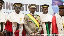 TOPSHOT - New interim Malian President, Colonel Assimi Goita (C), stands with members of the Supreme Court during his swearing in ceremony in Bamako on June 7, 2021. (Photo by ANNIE RISEMBERG / AFP) (Photo by ANNIE RISEMBERG/AFP via Getty Images)