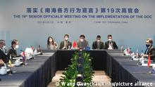 In this photo released by Xinhua News Agency, officials from China and the Association of Southeast Asian Nations (ASEAN) countries attend the 19th Senior Officials' Meeting on the Implementation of the Declaration on the Conduct of Parties in the South China Sea (DOC) in Chongqing, southwestern China, June 7, 2021. China is hosting foreign ministers from 10 Southeast Asian nations this week in the southwestern megacity of Chongqing amid heightened competition between Beijing and Washington for influence in the region. (Wang Quanchao/Xinhua via AP)