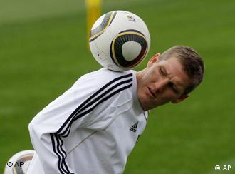 Germany's Bastian Schweinsteiger plays with the ball during a team training session in Tshwane, South Africa, Friday July 9, 2010. Germany will play Uruguay during the soccer World Cup in Port Elizabeth