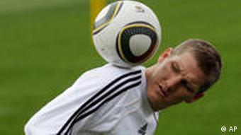 Germany's Bastian Schweinsteiger plays with the ball during a team training session in Tshwane, South Africa.