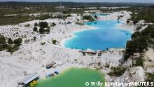 """*** Dieses Bild ist fertig zugeschnitten als Social Media Snack (für Facebook, Twitter, Instagram) im Tableau zu finden: Fach """"Images"""" —> Weltspiegel/Bilder des Tages *** 02.05.21 *** An aerial view shows a lake known as Kulong Biru (blue lake) in Koba, on the island of Bangka, Indonesia, May 2, 2021. Deposits in the mining hub of Bangka-Belitung have been heavily exploited on land, leaving parts of the islands off the southeast coast of Sumatra island resembling a lunar landscape with vast craters and highly acidic, turquoise lakes. Picture taken with a drone. REUTERS/Willy Kurniawan SEARCH KURNIAWAN TIN FOR THIS STORY. SEARCH WIDER IMAGE FOR ALL STORIES TPX IMAGES OF THE DAY"""