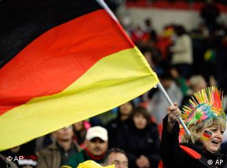 A German fan waves the national flag before the third-place game with Uruguay