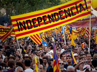 Demonstrators wave Catalan flags in a protest in downtown Barcelona