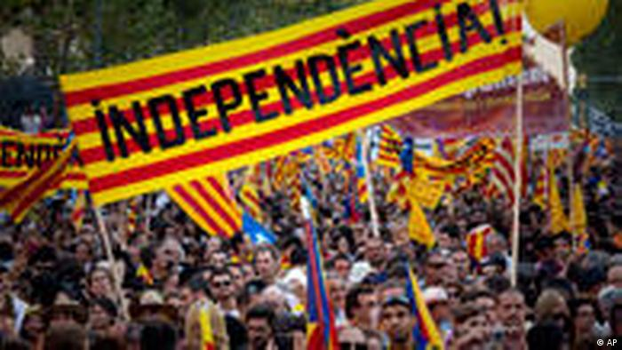 Demonstrators hold Catalan flags and shout slogans as they take part in a protest in Barcelona, Spain, Saturday, July 10, 2010. Thousands of demonstrators marched in Barcelona in favor of the Catalan charter that refers to Catalonia as a nation. (AP Photo/Emilio Morenatti)