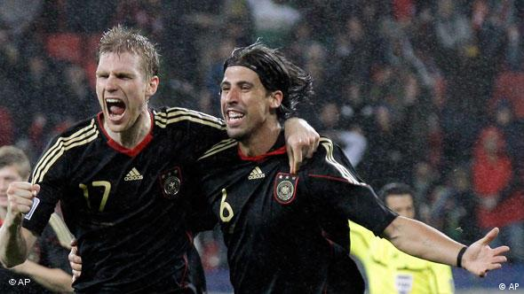 Germany's Sami Khedira, right, celebrates with teammate Germany's Per Mertesacker after scoring his side's third goal during the World Cup third-place soccer match between Germany and Uruguay at Nelson Mandela Bay Stadium in Port Elizabeth, South Africa, Saturday, July 10, 2010. Germany won 3-2.