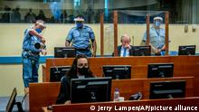 Former Bosnian Serb military chief Ratko Mladic sits in the court room in The Hague, Netherlands, Tuesday, June 8, 2021, where the United Nations court delivers its verdict in the appeal of Mladic against his convictions for genocide and other crimes and his life sentence for masterminding atrocities throughout the Bosnian war. (Jerry Lampen/Pool via AP)