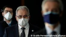 Brazil's Health Minister Marcelo Queiroga, center left, arrives to testify before the Senate during an investigation of the government's management of the COVID-19 pandemic, in Brasilia, Brazil, Tuesday, June 8, 2021. (AP Photo/Eraldo Peres)