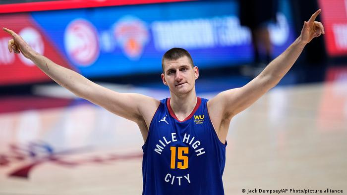 Denver Nuggets center Nikola Jokic (15) celebrate the team's double-overtime win against the Portland Trail Blazers in Game 5 of a first-round NBA basketball playoff series Tuesday, June 1, 2021, in Denver.