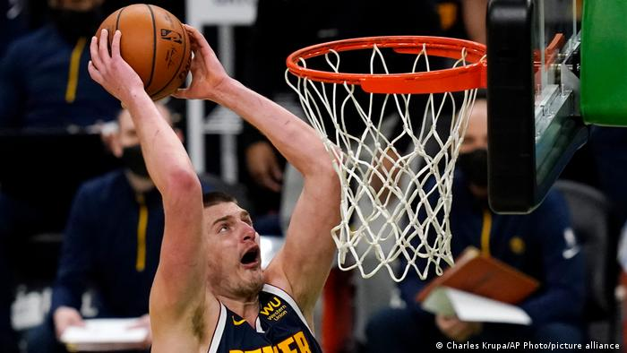 Denver Nuggets center Nikola Jokic (15) lines up a dunk during the first half on an NBA basketball game, Tuesday, Feb. 16, 2021, in Boston.