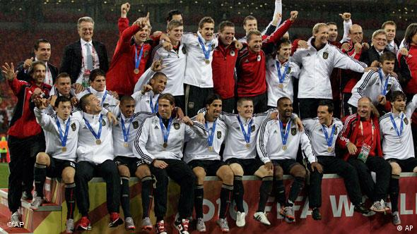 Germany players celebrate beating Uruguay 3-2 to secure third place at the 2010 World Cup