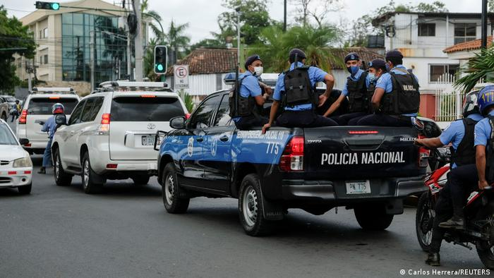 Nicaraguan police sit in the back of a police truck