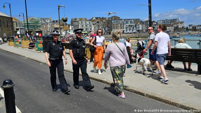 Two police officers walk in St Ives, Cornwall