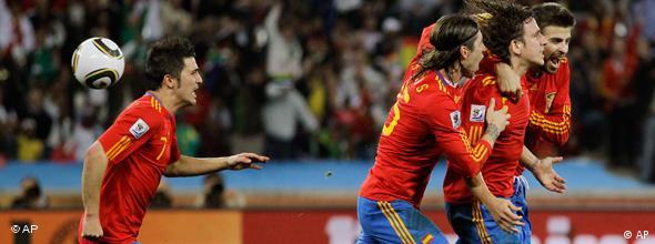 Spain players celebrate a goal