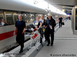 People receiving medical attention on platform