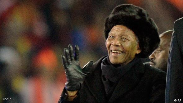 Former South African President Nelson Mandela waves as he is driven across the field during the closing ceremony ahead of the World Cup final soccer match between the Netherlands and Spain at Soccer City in Johannesburg, South Africa, Sunday, July 11, 2010. (AP Photo/Martin Meissner