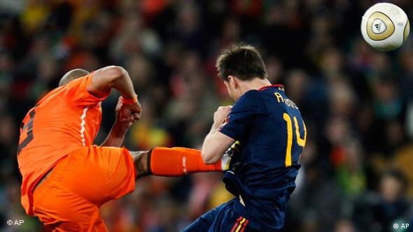 Netherlands midfielder Nigel de Jong fouls his Spanish counterpart Xabi Alonso during the World Cup final