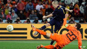 Spain's Andres Iniesta, back, scores the goal