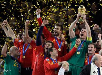 Spain goalkeeper Iker Casillas, right, holds up the World Cup trophy