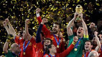 Spain goalkeeper Iker Casillas holds up the World Cup trophy after the World Cup final soccer match
