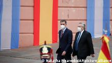 Spain's Prime Minister Pedro Sanchez, left, walks with Argentina's President Alberto Fernandez before a news conference during his one day visit to Buenos Aires, Argentina, Wednesday, June 9, 2021. (AP Photo/Natacha Pisarenko)