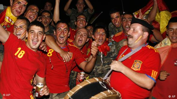 Spanish soldiers serving with the United Nations Interim Force in Lebanon (UNIFIL) cheer as they watch a live broadcast of the World Cup soccer final between Spain and the Netherlands, which is being played in South Africa, at their base in the village of Blatt, near the southern town of Marjayoun, Lebanon, Sunday, July 11, 2010. (AP Photo/Lutfallah Daher)