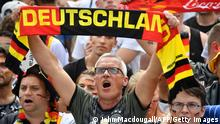 27.6.2018, Berlin, Deutschland, Supporters of the German national football team sing the national anthem as they attend a public viewing event at the Fanmeile in Berlin to watch the Russia 2018 World Cup Group F football match between South Korea and Germany on June 27, 2018. (Photo by John MACDOUGALL / AFP) (Photo credit should read JOHN MACDOUGALL/AFP via Getty Images)