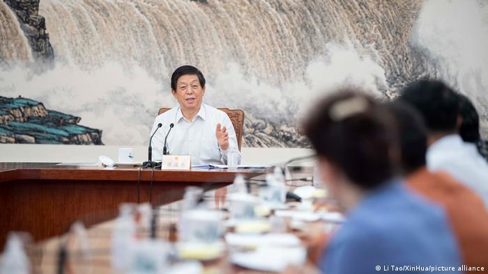 Li Zhanshu leads a meeting of the Standing Committee of the National People's Congress (NPC) in Beijing, China