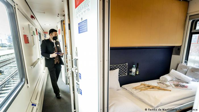 A compartment on an overnight train while sitting in Amsterdam Central train station