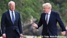 10.6.2021, Cornwall, England, Britain's Prime Minister Boris Johnson speaks with U.S. President Joe Biden while they walk with their wife Carrie Johnson (not seen) and U.S. first lady Jill Biden (not seen), outside Carbis Bay Hotel, Carbis Bay, Cornwall, Britain June 10, 2021. REUTERS/Toby Melville/Pool