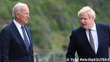 Britain's Prime Minister Boris Johnson speaks with U.S. President Joe Biden while they walk outside Carbis Bay Hotel, Carbis Bay, Cornwall, Britain June 10, 2021. REUTERS/Toby Melville/Pool