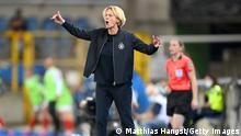STRASBOURG, FRANCE - JUNE 10: Martina Voss-Tecklenburg, Head Coach of Germany gives her team instructions during the Women's International Friendly match between France and Germany at La Meinau Stadium on June 10, 2021 in Strasbourg, France. (Photo by Matthias Hangst/Getty Images)