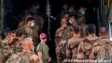 French Barkhane force soldiers who wrapped up a four-month tour of duty in the Sahel board a US Air Force C130 transport plane, leave their base in Gao, Mali, Wednesday June 9, 2021. France has suspended joint military operations with Malian forces until the junta led by Col. Assimi Goita, who retook control of Mali's transitional government May 24, complies with international demands to restore civilian rule. (AP Photo/Jerome Delay)