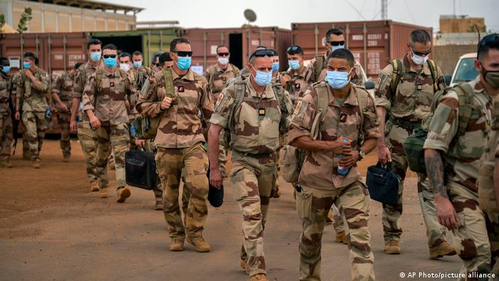 French soldiers march in Mali