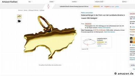 A gold pendant shaped like Ukraine
