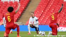 Jordan Henderson kneels ahead of a game between England and Belgium