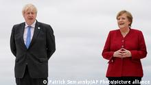 British Prime Minister Boris Johnson and his wife Carrie Johnson pose for photos with German Chancellor Angela Merkel and her husband Joachim Sauer at the G-7 summit, Friday, June 11, 2021, in Carbis Bay, England. (AP Photo/Patrick Semansky, Pool)