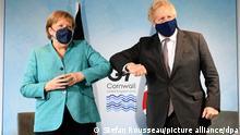 Britain's Prime Minister Boris Johnson, right, greets German Chancellor Angela Merkel ahead of a bilateral meeting during the G7 summit in Cornwall, England, Saturday June 12, 2021. (Stefan Rousseau/Pool via AP)