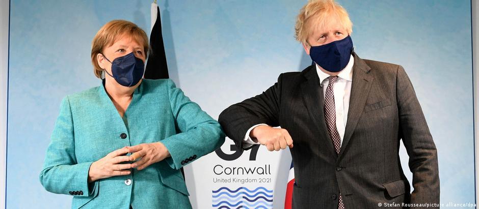 Britain's Prime Minister Boris Johnson, right, greets German Chancellor Angela Merkel