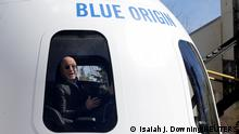 FILE PHOTO: Amazon and Blue Origin founder Jeff Bezos addresses the media about the New Shepard rocket booster and Crew Capsule mockup at the 33rd Space Symposium in Colorado Springs, Colorado, United States April 5, 2017. REUTERS/Isaiah J. Downing/File Photo/File Photo