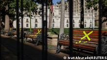 Benches are seen taped off in front of the government palace as Chilean health authorities start a blanket lockdown across the capital, during the outbreak of the coronavirus disease (COVID-19) in Santiago, Chile June 12, 2021. REUTERS/Ivan Alvarado